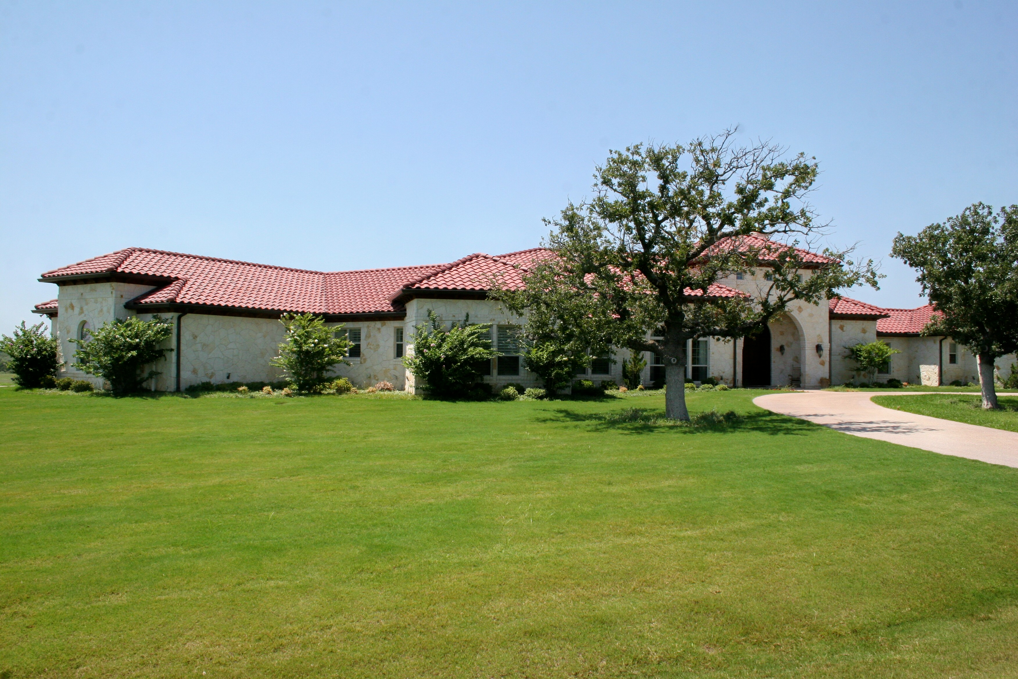 This Beautiful Terranean Style Home Was Built In Parker County Close To The Palo Pinto Line A Red Tile Roof And Austin Stone Give